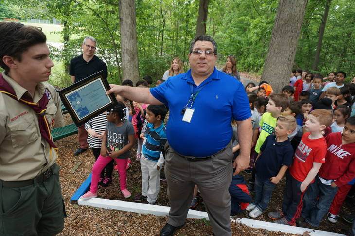 643a06d2c63276435ae1_a_Woodmont_Principal_Dominic_Esposito_speaks_at_the_dedication_ceremony.JPG
