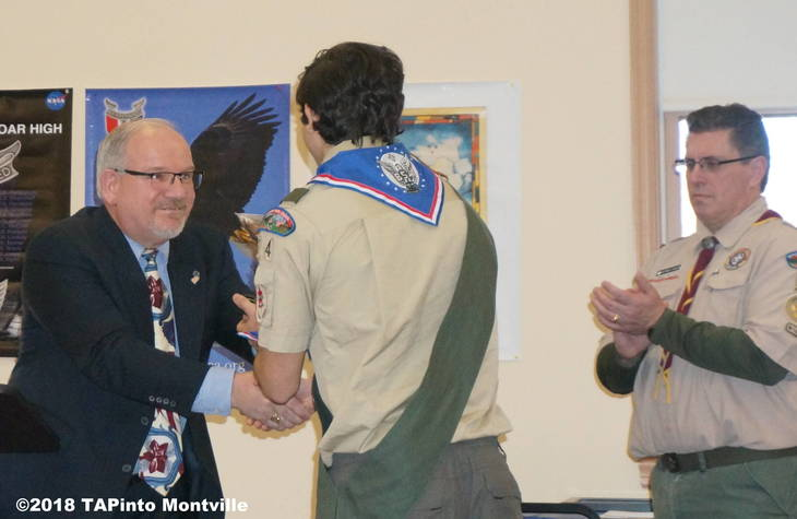 65f8fc1b2204c31f986d_a_Former_Mayor_Jim_Sandham_shakes_Michael_Manetta_s_hand_as_Scoutmaster_Patrick_Phalen_looks_on__2018_TAPinto_Montville.JPG