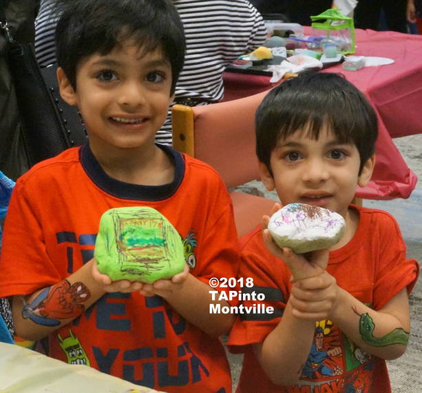 67964b769fdf53b57f9e_a_Zakariyya_and_Yahya_show_off_their_arm_paintings_and_their_painted_rocks_at_the_library__2018_TAPinto_Montville___1..JPG