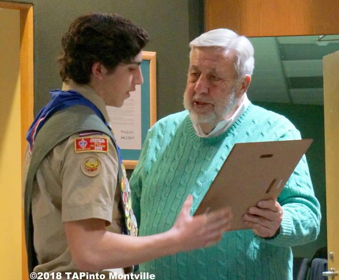 696b61a067f011adbbac_a_Eagle_Scout_Michael_Manetta_receives_a_proclamation_from_Board_President_Charles_Grau.JPG