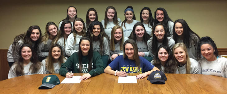 6a92e97148cee031091a_Sarafin_and_Sansone_Sign_with_Teammates.jpg