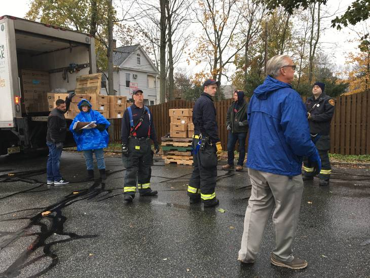 The Giving Spirit: Rain Doesn't Deter Morristown Employees from Distributing Frozen Turkeys To Those in Need