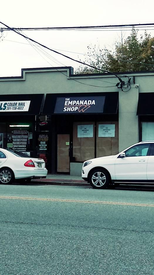 6f4a62350e3f579e63e2_Empanada_Shop_WR_vert_pix.jpg