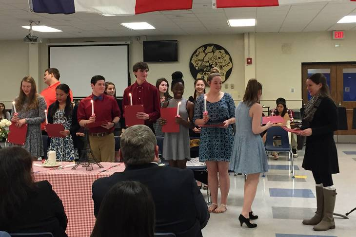 70cffa3f57aca4548112_1bd19a808570aabed25f_French_Students_Being_Inducted.jpg