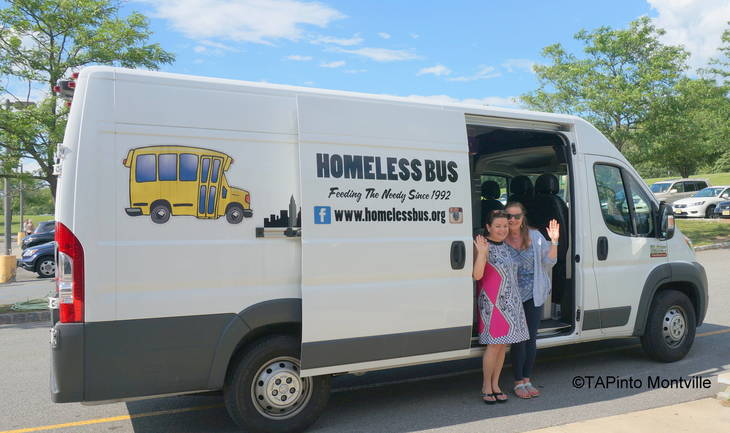 71787e00cdac6f8c356f_a_Anna_Landgrebe_and_Rebecca_Finnerty_accept_donations_for_the_Homeless_Bus_water.JPG