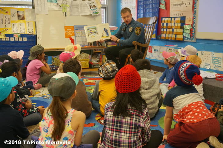 75409ae5fc5ffea680ff_a_Montville_Township_Police_Officer_Scott_McGowan_reads_to_kindergarteners_at_Woodmont__2018_TAPinto_Montville.JPG