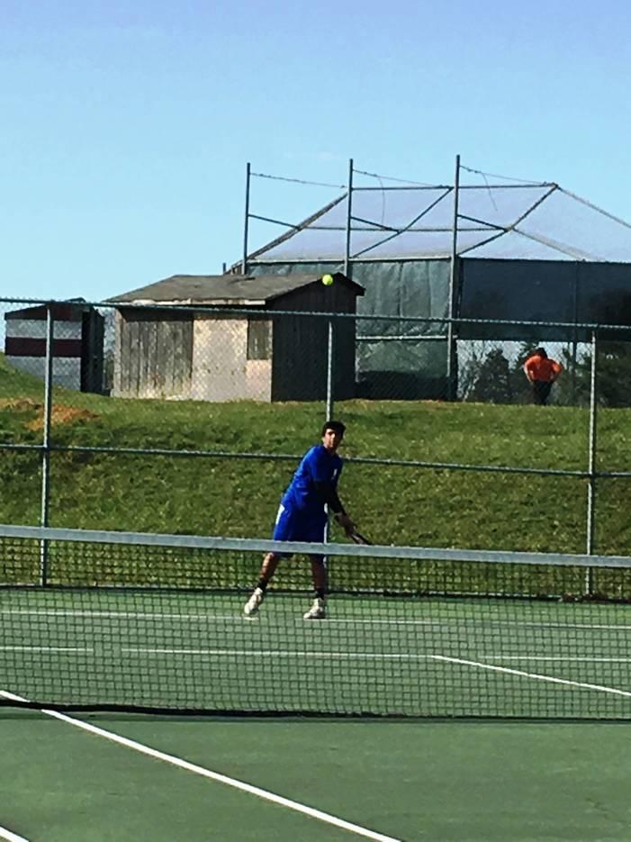 7604913d67aad5b79061_tennis3.JPG