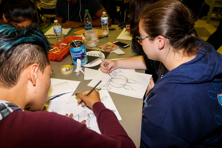 775352f7752377c3f965_Students_work_on_collaborative_drawings.jpg