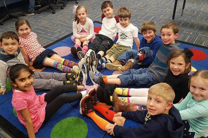 7a0b856771f3bc24c8e9_d50627fc21dcc30dd9ec_Lamonts_Kindergarten_class_showing_off_crazy_socks.jpg