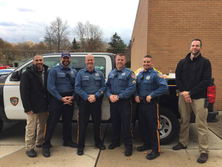 7a370ceb367f1da75fc3_Roxbury_Police_Officers_who_came_to_thank_the_students_and_pick-up_the_food.JPG