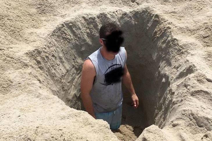 7cb7cea35ec6278769af_b3835c9214b3293cd05b_beach_hole_digging_warning.jpg
