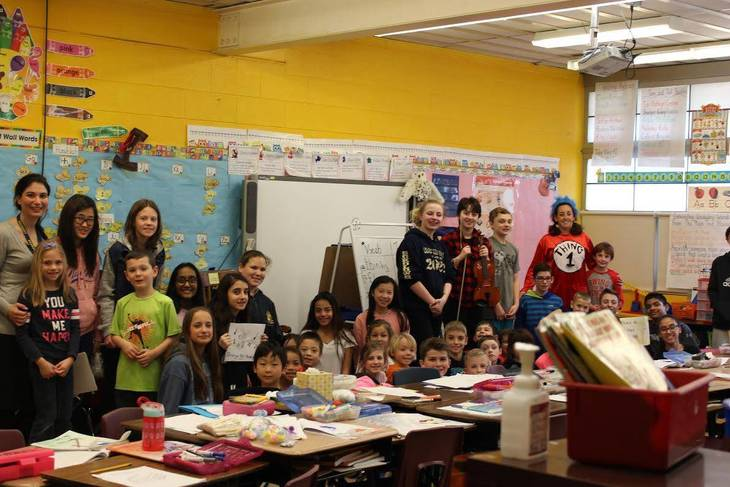 7de71462ce111c5fb9c4_Iuvone_1st_grade_students_with_Farina_7th_grade_students_from_EMS.jpg