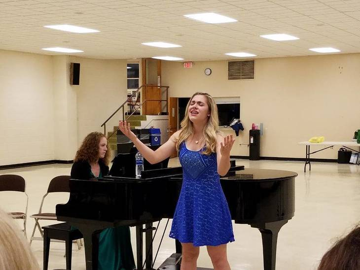 7fbe8165ad6283a6a091_Christina_performing_2018.jpg