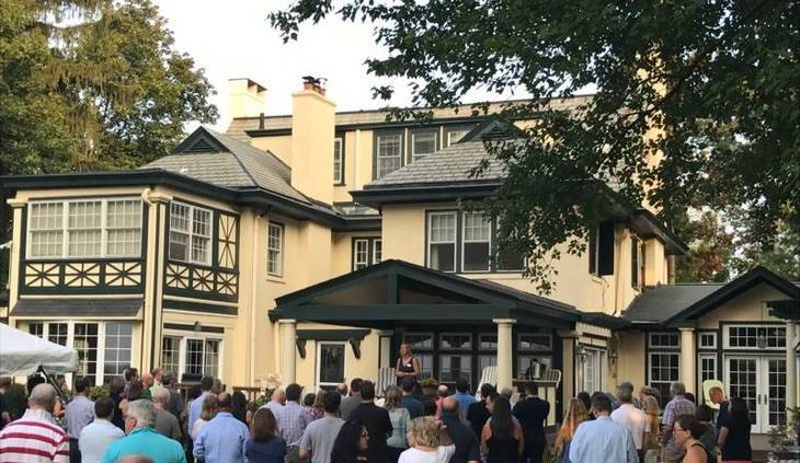 805ef36e0a2688fccf18_Shelley_Brindle_addresses_crowd_at_Hertell_residence.jpg