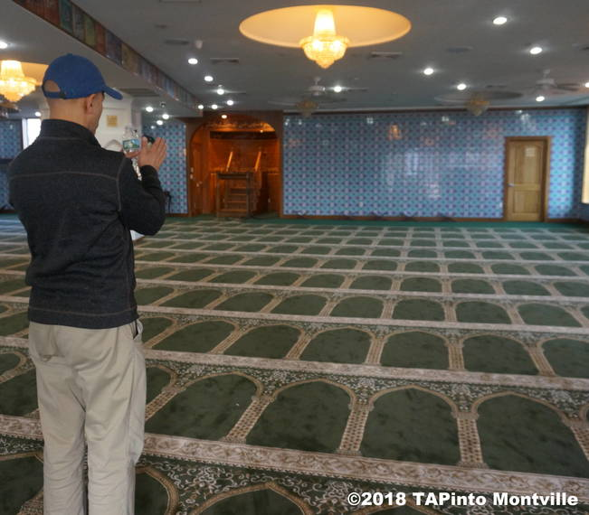 80803af4f1b5f222989f_a_Jam-E-Masjid_Islamic_Center_s_Gul_Khan_explains_how_the_motifs_on_the_carpet_help_orient_those_praying_towards_Mecca__2018_TAPinto_Montville.JPG