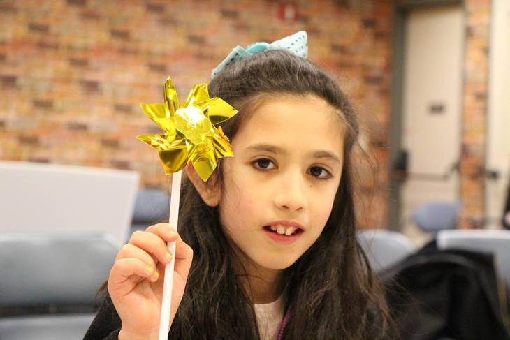 80a4e1ceae07405366d6_EDIT_girl_with_yellow_pinwheel.jpg