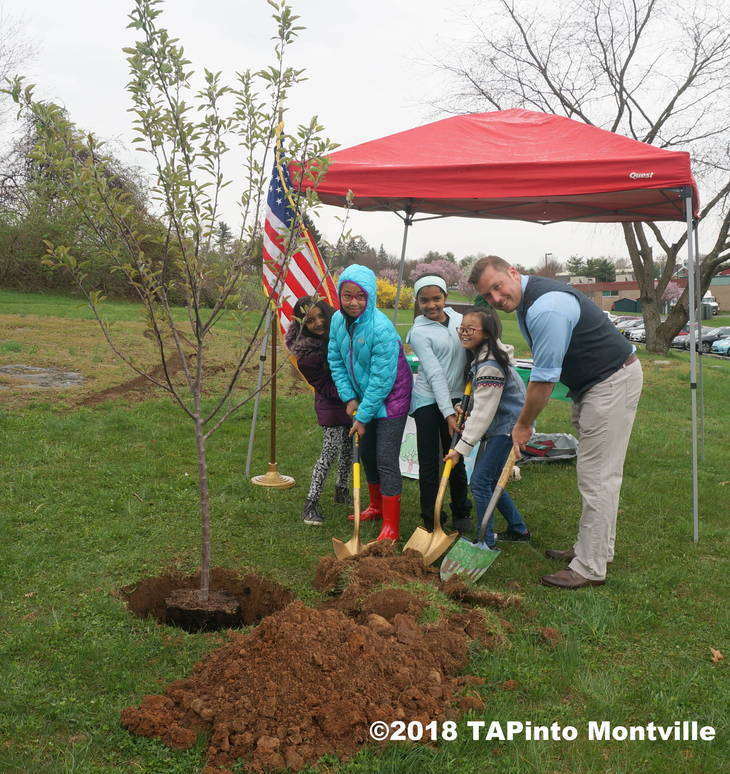 879cbca45120e5445da2_a_The_poster_contest_winners_and_honoree_Paul_Rolfe_get_ready_to_plant_the_apple_tree__2018_TAPinto_Montville.JPG