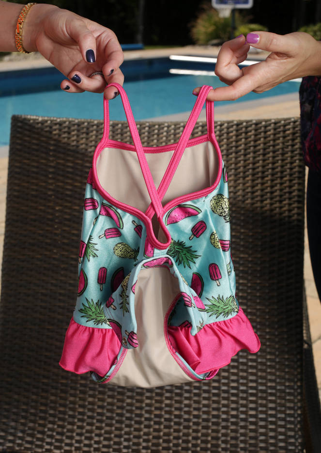 898c468d64ba3d50205a_back_of_fasten_swimsuit_open_with_magnet_attached.jpg