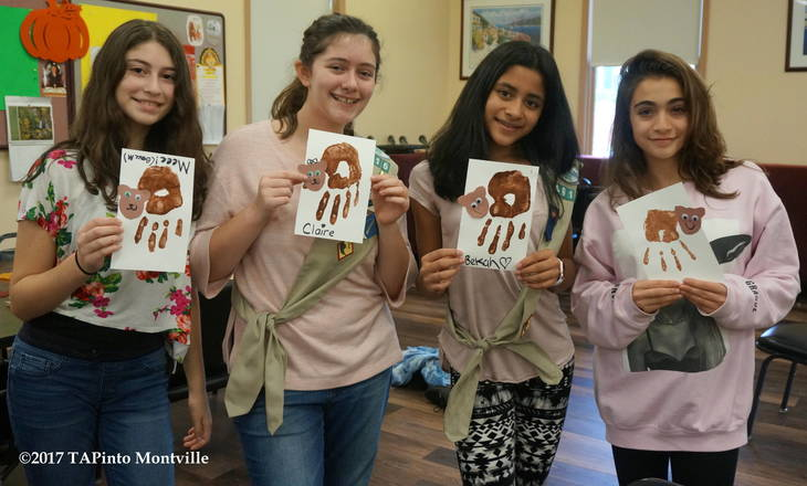 8d6df968e4432d429a98_a_The_Girl_Scouts_with_their_teddy_bear_hands__2017_TAPinto_Montville.JPG