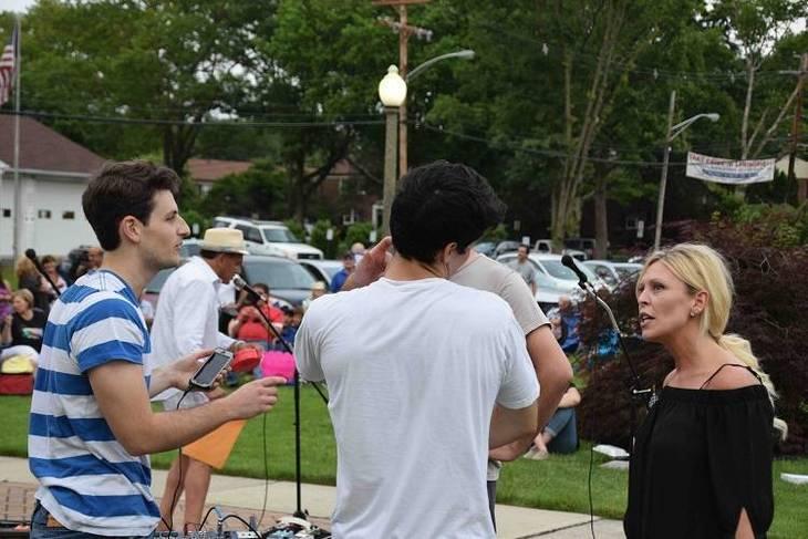 8e2971e750b47fc276ab_Band_on_break_socializing_with_mayor.jpg