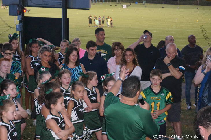 90f617be0800e956c5ef_a_Joe_Colella__with_microphone__speaks_as_members_of_the_Vagias_and_Cali_families_look_on.JPG