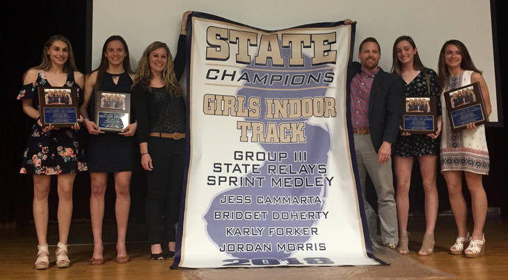 92a40afd4b033f1498f2_Group_3_State_Champions_with_Coaches.JPG