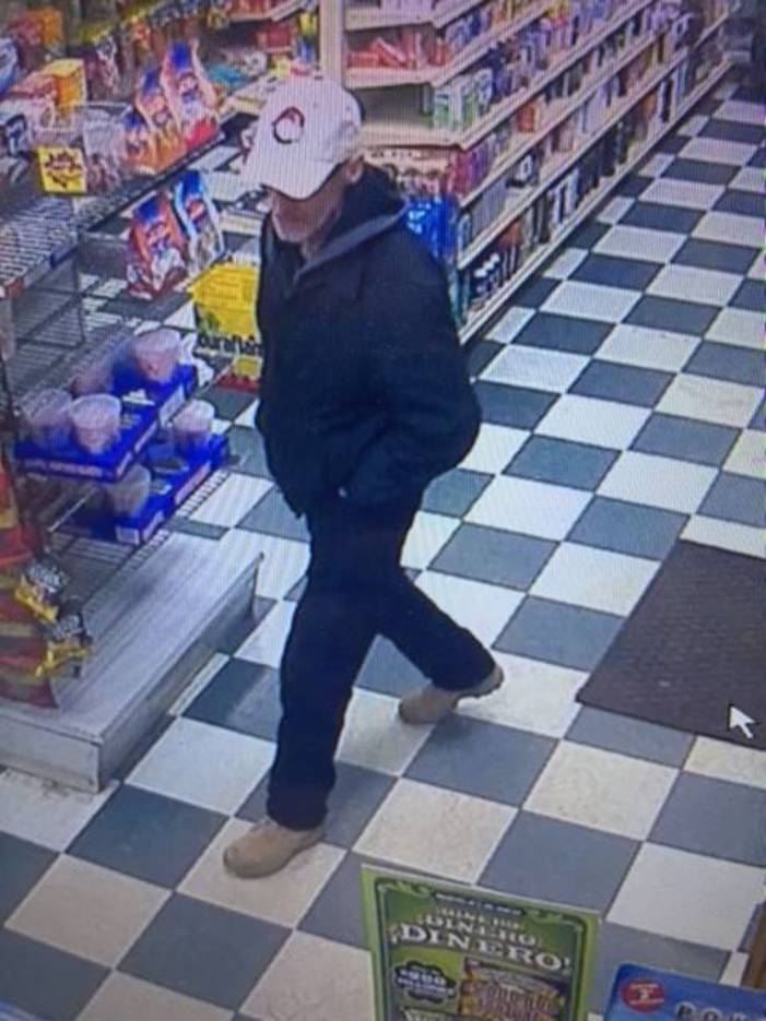949c96e903abf2734eef_armed_robber_walking_in_store.JPG