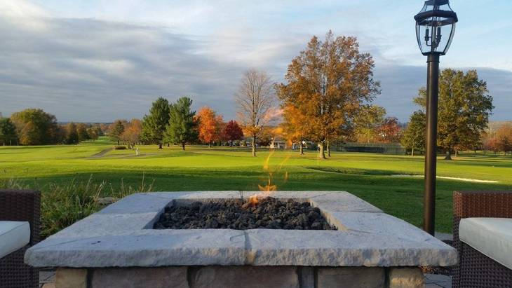 9abff7eeb7f247efd06a_Fire_pit_overlooking_golf_course.jpg