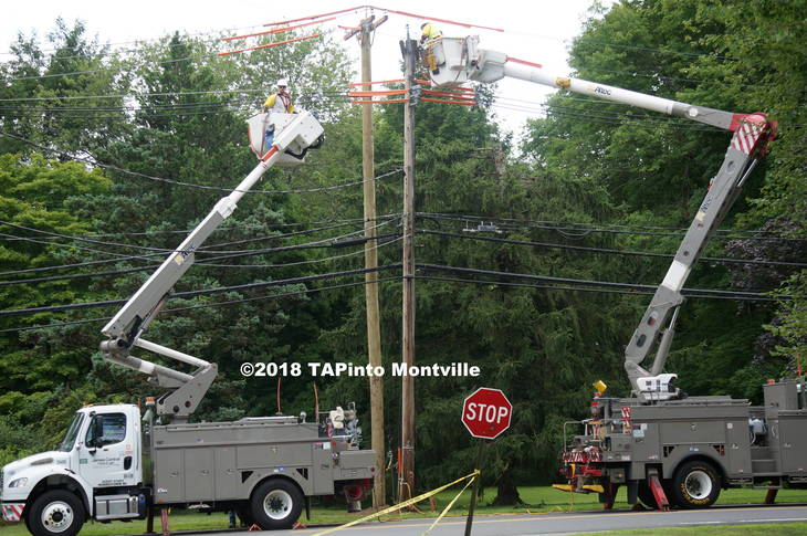 b0b9aa29daa779d7c114_a_Work_on_transferring_wires_to_the_new_pole_commences_in_the_early_afternoon_of_July_22__2018_TAPinto_Montville__1..JPG