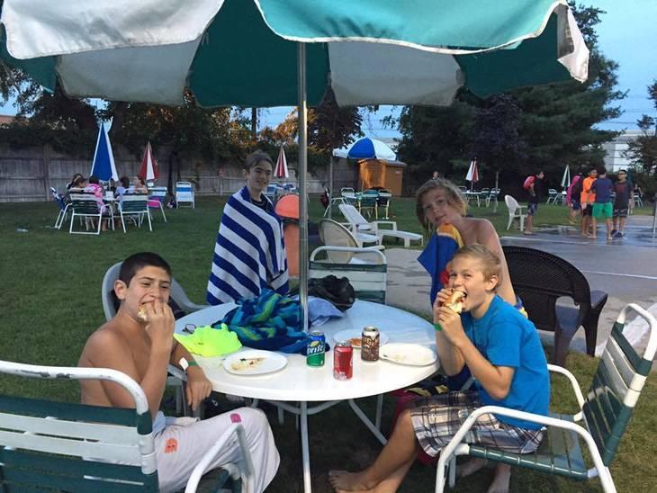 b108bfc0a7bf6a4e9025_HHSC_teen_night_2_boys_eating.jpg