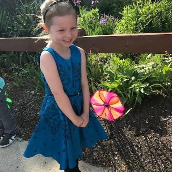 b19d091d91ebb794bb54_7715eeeb20bd931e6a69_Caelyn_Douglas_planting_a_flower_pinwheel_in_the_RHS_garden_before_the_preschool_Graduation.JPG