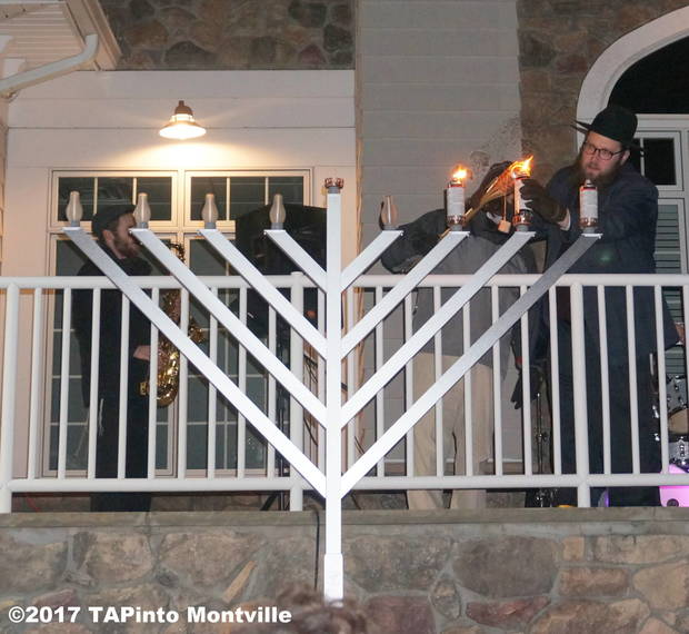 b3ad223d66430a032f54_a_Lighting_the_two-story_menorah__2017_TAPinto_Montville.JPG
