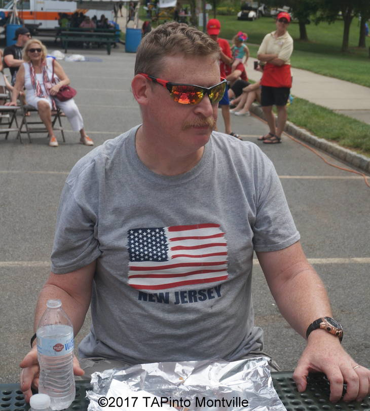 b8517623a3f656f20443_a_Daniel_Longo_in_front_of_his_empty_plate_after_winning_the_hot_dog-eating_contest.JPG