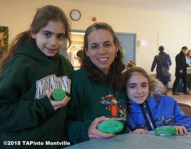 b935d273fc5b15dc0f0b_DSC07536a_Allyson_Sheri_and_Hailey_Dragone_show_the_green_rocks_they_inscribed_with_encouraging_statments__2018_TAPinto_Montville.JPG