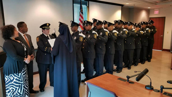 b9a87e5f3fca49b26801_police_graduation_2.jpg