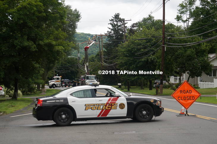 ba8ef190863d8470d717_a_Jacksonville_Road_closed_as_workers_remove_the_damaged_vehicle_and_transfer_the_wires_to_the_new_utility_pole__2018_TAPInto_Montville___1..JPG