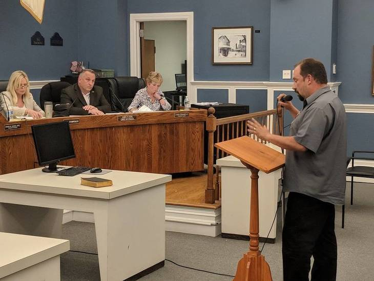 babb764b24b9e3b60030_Republican_candidate_Jerry_Fernandez_expressing_his_concerns_during_a_public_comment_session.jpg