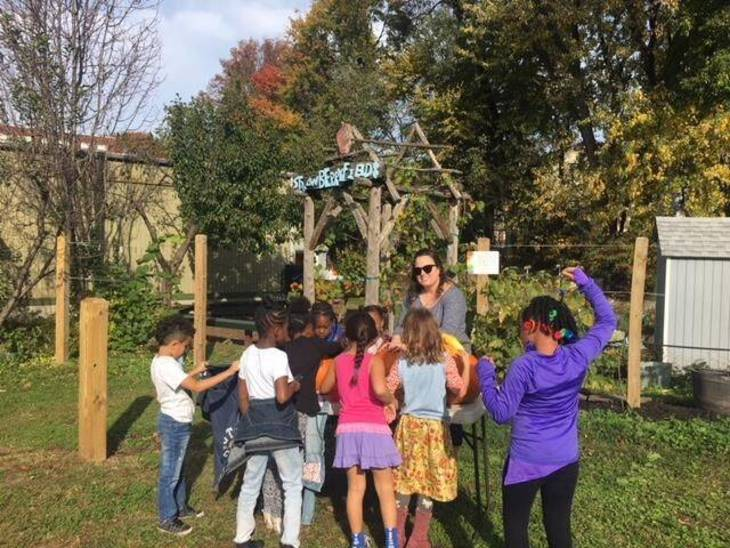 c2ca0dbc28a32d83f56e_Garden_Recess_Fall_2017_3_Group_shot_with_Strawberry_Fields_sign_preview.jpeg