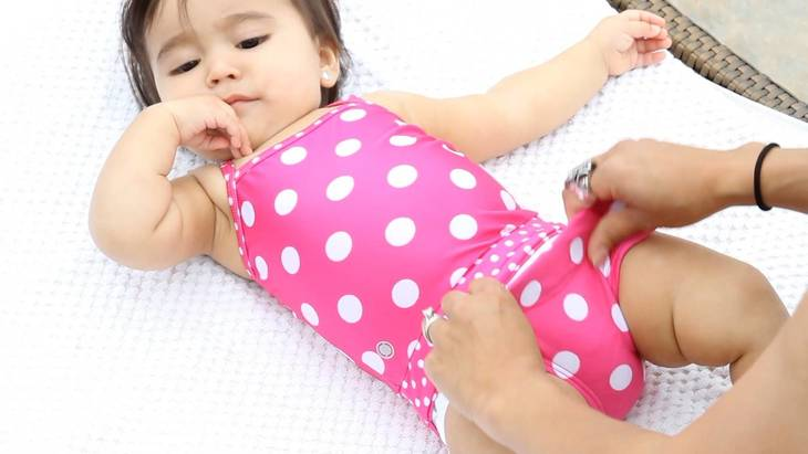 c3f62a0bb5af61879ad8_baby_in_fasten_swimsuit_about_to_have_diaper_change.jpg