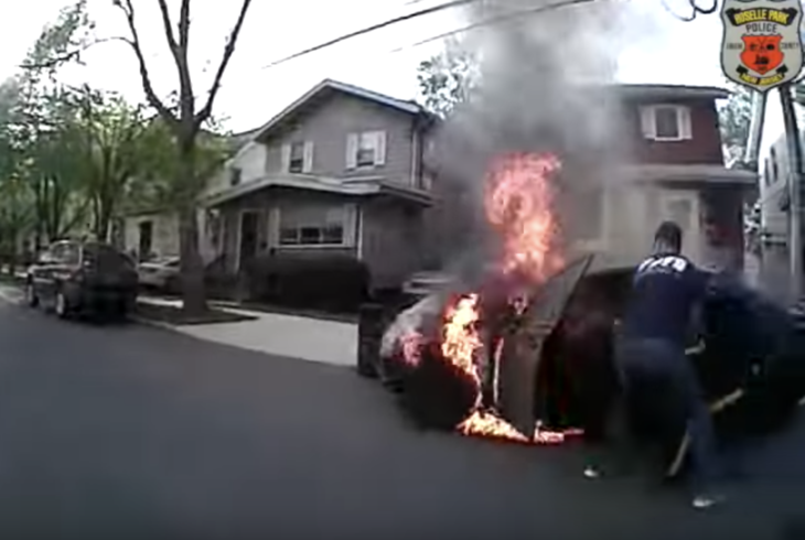 Police scramble to pull sleeping man from burning vehicle