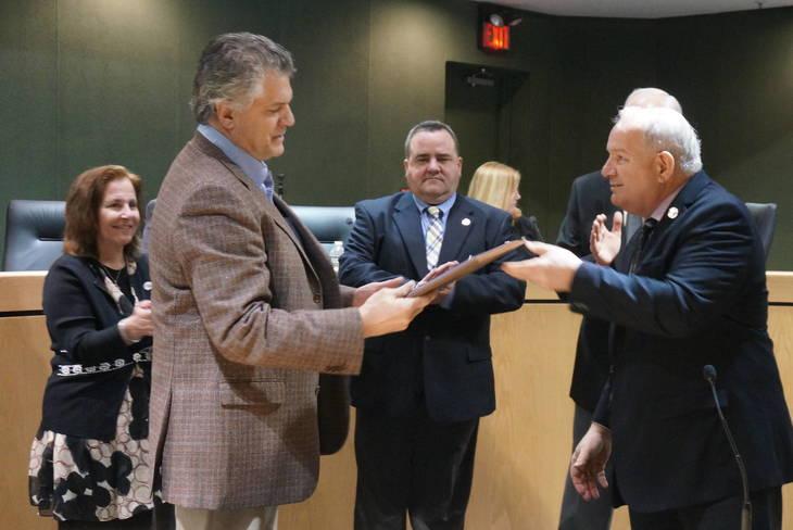 c8acffab84903fdeb60b_a_Paul_Mudd_receives_his_proclamation_from_Mayor_Jim_Sandham.JPG