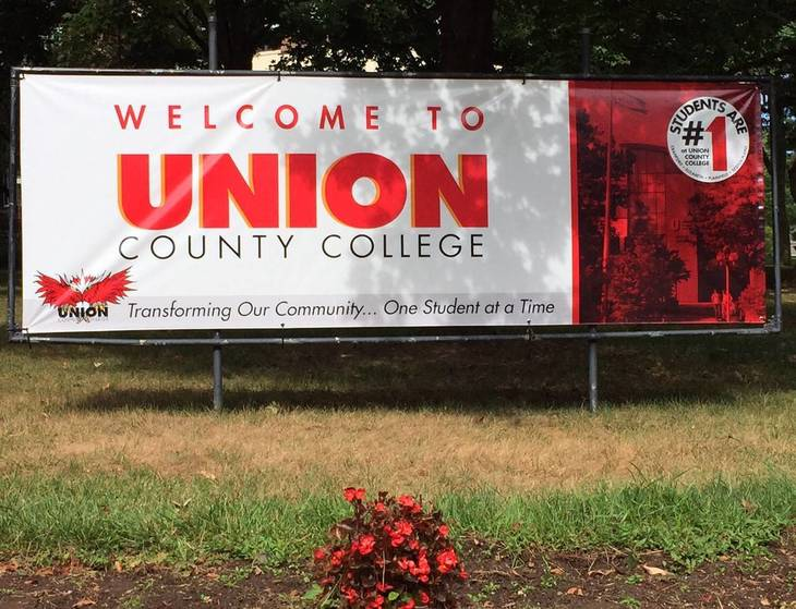 ca469a1038d823c7943c_UCC_sign_on_Campus.jpg