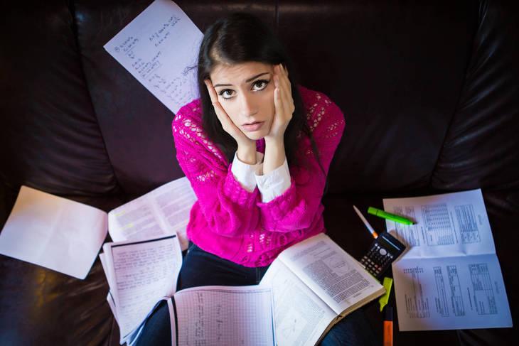 cb11010aa57f6132e3a6_bigstock-Tired-student-having-a-lot-to--78889934.jpg