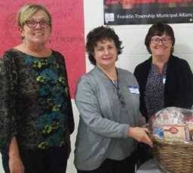 cb1ee584a2810acc53a8_Phyllis_Beals_Mary_Lou_Bok_and_Lisa_Andreini_pack_Thanksgiving_Baskets.jpg