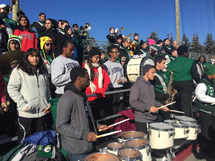 cef45b5f97a9613e29ab_Marching_Band_-_Performs_with_Alumni_in_Stands.jpg