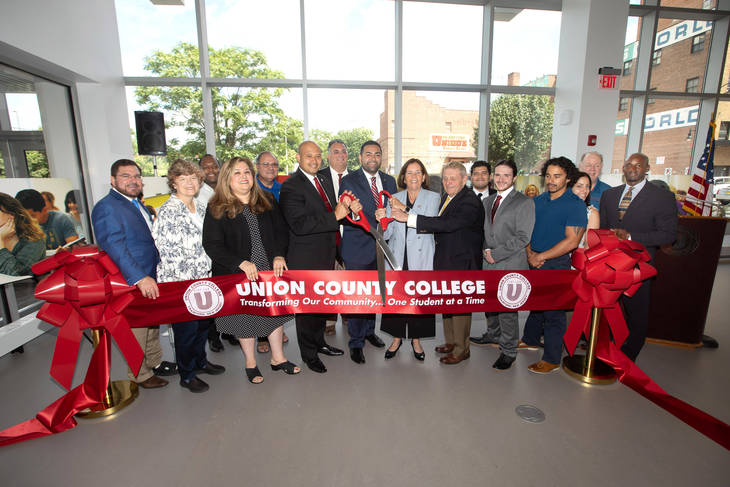 cffdff336353786f9f32_Ribbon_Cutting_Group_Photo_Lessner.jpg