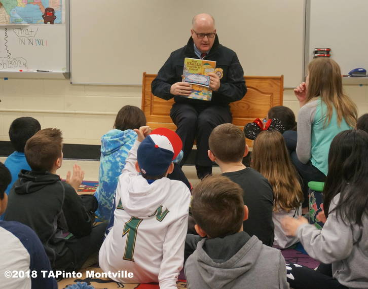 db7caffa00b91dd1967d_a_Sheriff_James_Gannon_reads_to_Woodmont_students__2018_TAPinto_Montville_____1.JPG