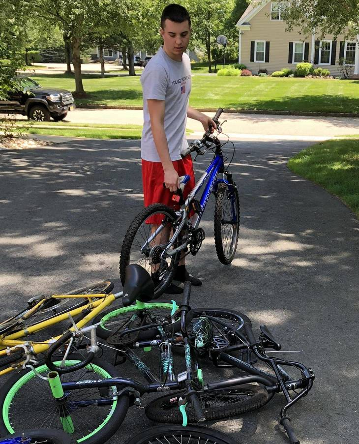 dd2c29f543fa2c2f0549_Alex_Iervolino_sorts_bikes_on_his_driveway_Courtesy_of_Mary_Iervolino________2.jpg