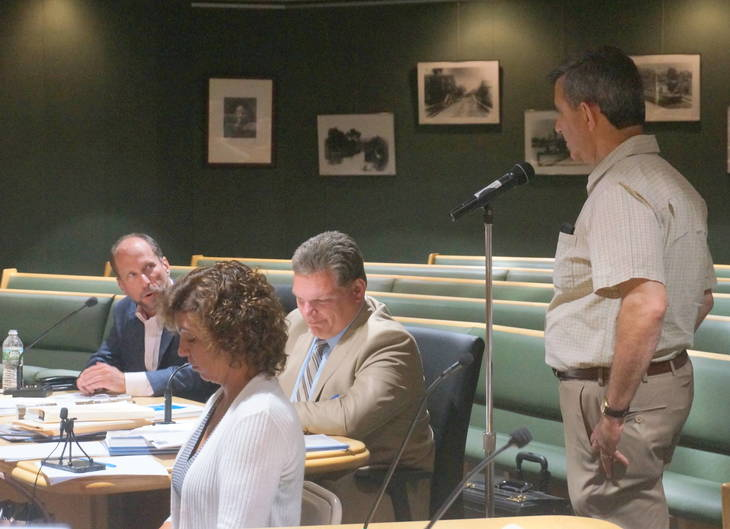 dd6b4fbbef59108a8b7b_a_Board_of_Ed_Member_Mike_Palma_asks_questions_of_Ron_Ladell__far_left.JPG