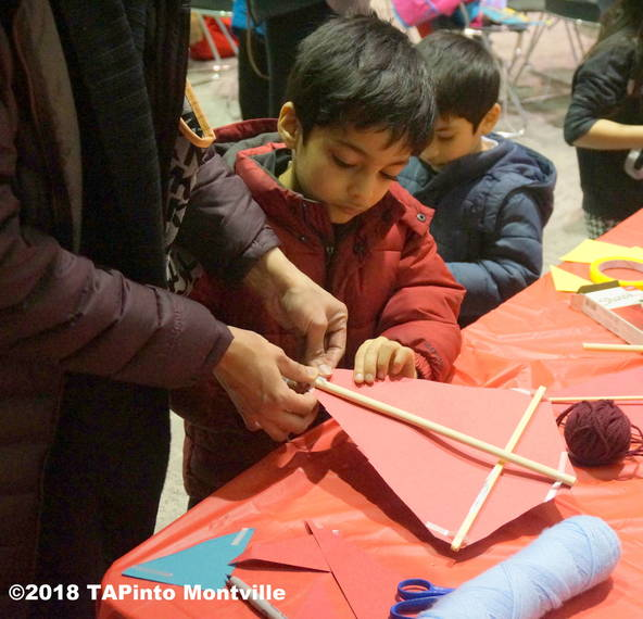 dd809b809e37ff0205c4_a_Making_mini_kites_at_the_Library_s_Lunar_New_Year_celebration__2018_TAPinto_Montville_1.JPG